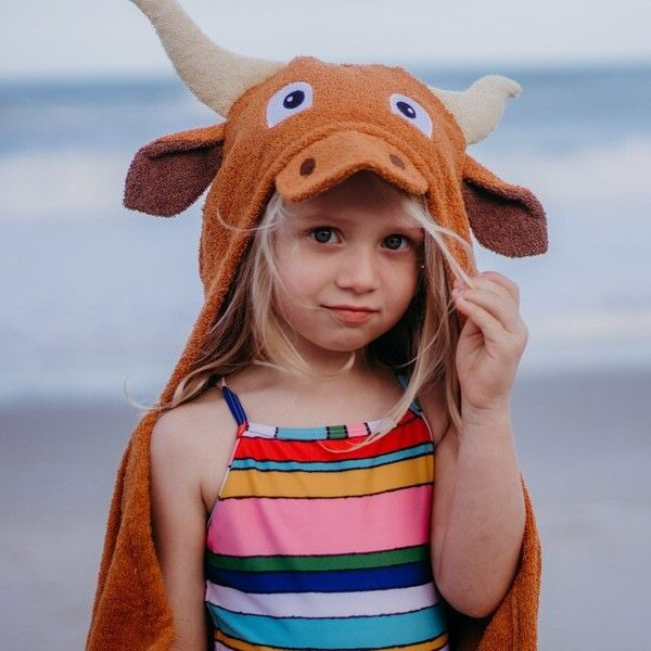 The Yikes Twins steer hooded towel will keep kids cozy while playing at the beach or pool