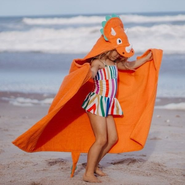 Children will love wearing a triceratops dinosaur hooded towel at the beach or pool